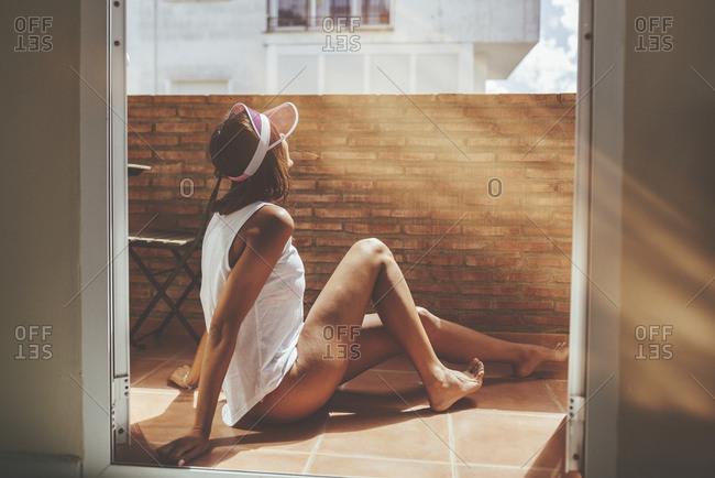 Woman sunbathing on a balcony