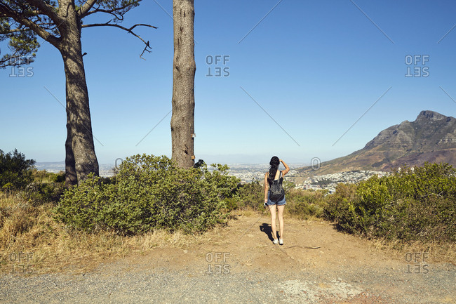 South Africa- Cape Town- Signal Hill- young woman overlooking the city
