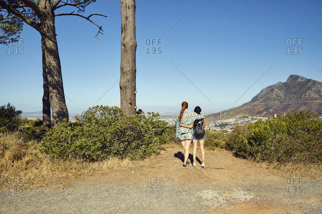 South Africa- Cape Town- Signal Hill- two young women overlooking the city