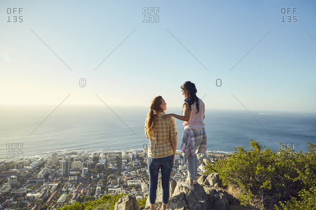 South Africa- Cape Town- Signal Hill- two young women overlooking the city and the sea