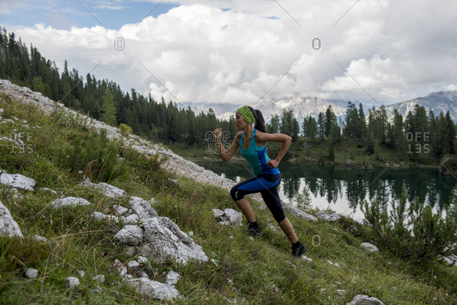Italy- Dolomites- Veneto- trail runner at Federa Lake