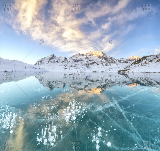 Panorama of ice bubbles and frozen surface of Lago Bianco at dawn Bernina Pass canton of Graub�_nden Engadine Switzerland Europe