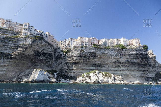 The turquoise sea frames the ancient village perched on the white cliffs Lavezzi Islands Bonifacio Corsica France Europe