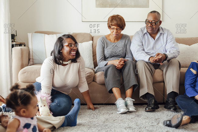 Multi generational family spending leisure time together in living room at home