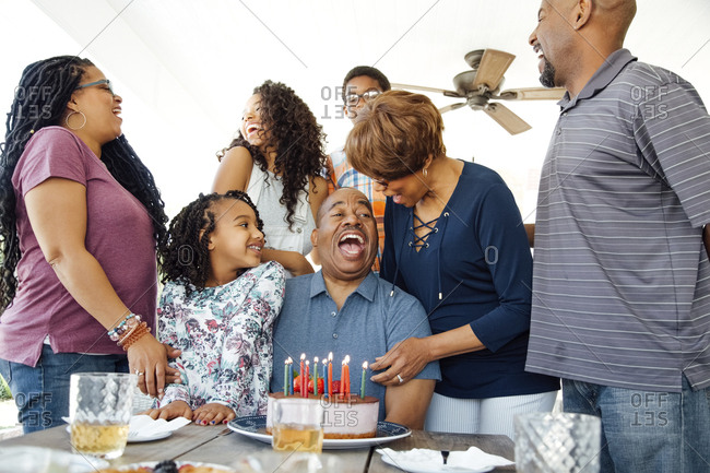 Happy multi generational family enjoying birthday party at patio
