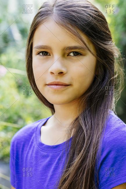 Closeup portrait of confident girl outdoors