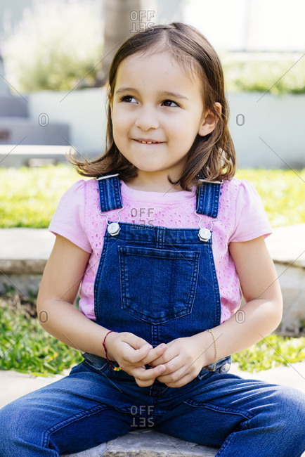 Portrait of cute girl wearing overalls