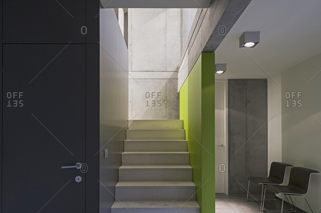 Stairway with one green wall in modern office building