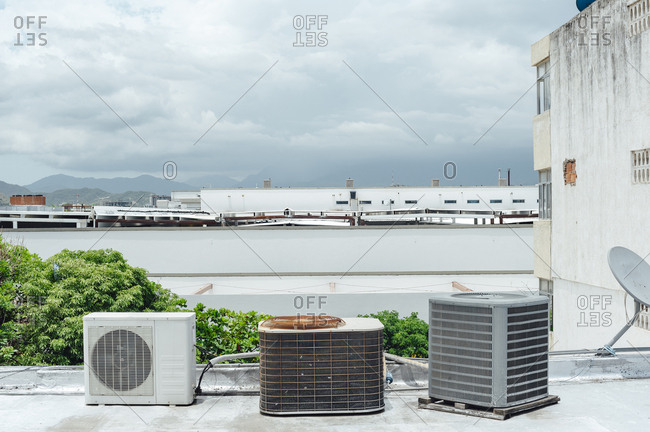 Three air conditioner machines in a row up to a rooftop in Santa Marta, Colombia