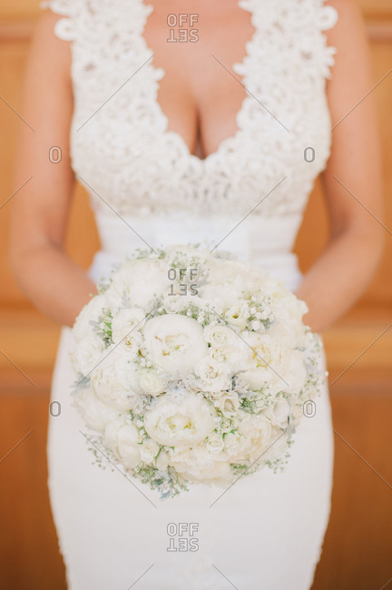 Bride with floral bouquet in hand