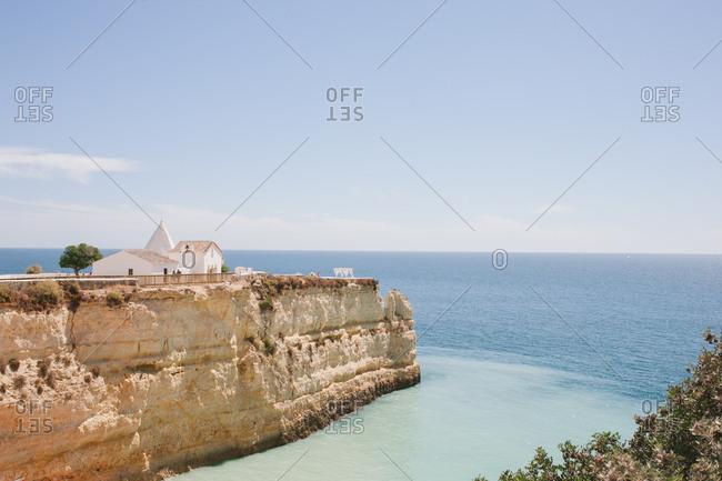 Senhora da Rocha, Portugal - February 4, 2017: A church on cliff overlooking sea