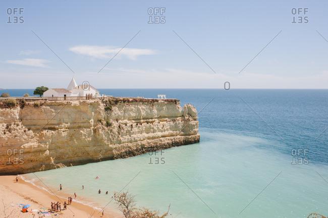 Senhora da Rocha, Portugal - February 4, 2017: A church on cliff overlooking ocean