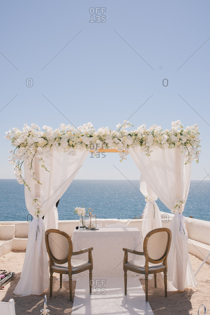 Chairs and arch for seaside wedding