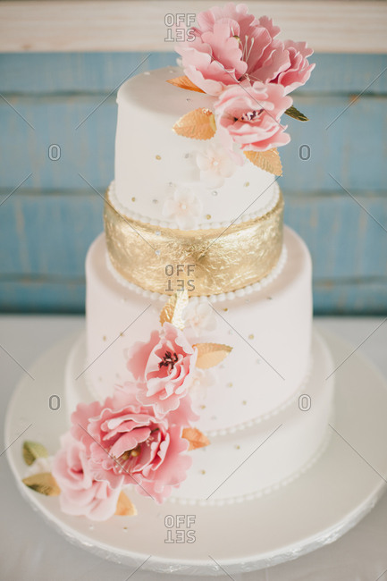 Wedding cake with a gold tier
