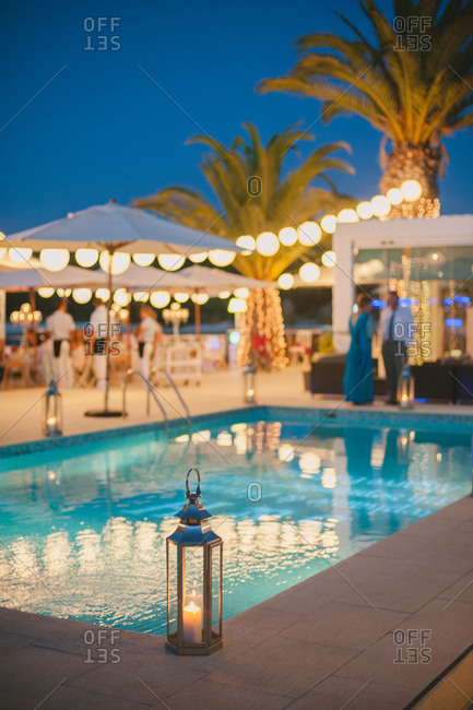 Poolside wedding reception at dusk, Portugal