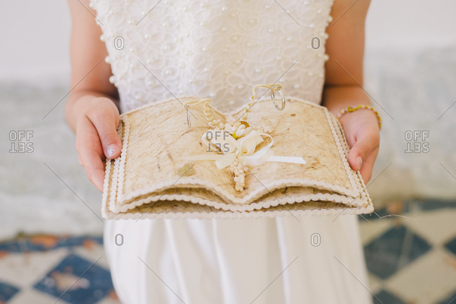 Bride carrying wedding ring holder
