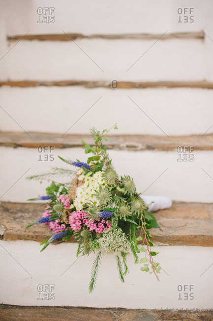 Floral arrangement on rustic stairs