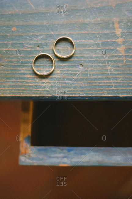Two wedding bands on old desk