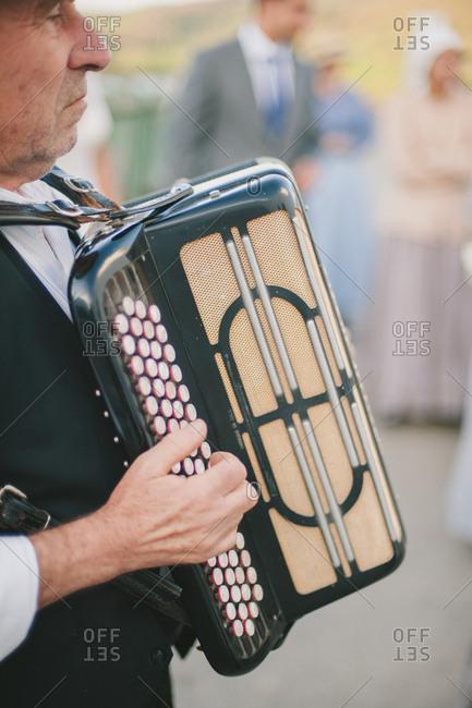Man playing accordion at wedding