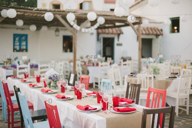 Tables set for dinner on terrace, Portugal