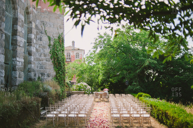Wedding ceremony by stone building