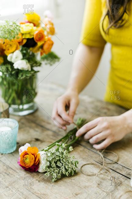 Woman preparing bouquet