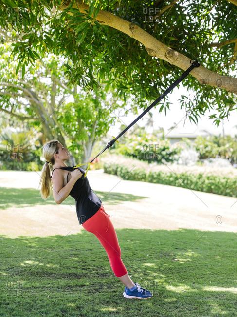 USA, Hawaii, Kauai, Woman doing fitness training