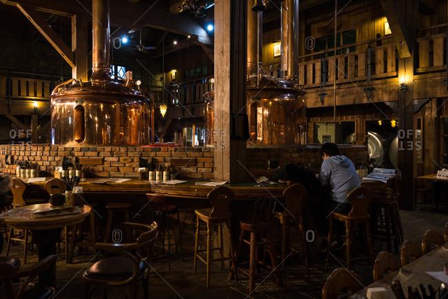 Otaru, Japan - January 9, 2017: People at old bar, Otaru.