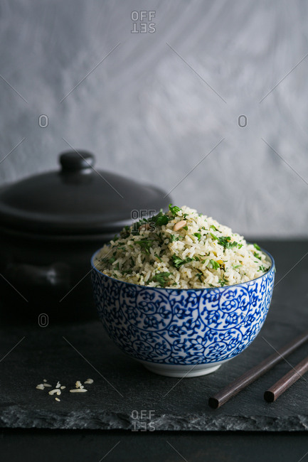 Single bowl of rice on a slate board