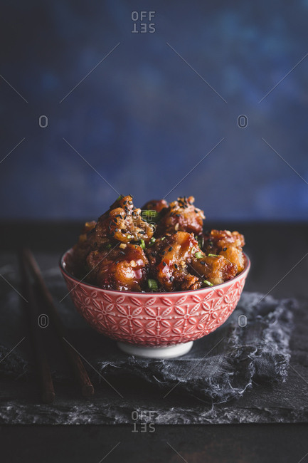Bowl of honey garlic spareribs on a slate board