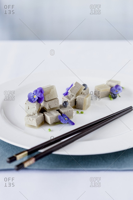 Chinese sweet tofu dessert with chopsticks