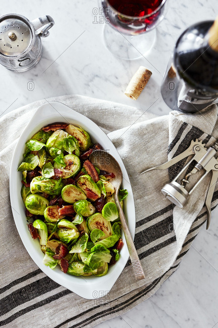 Roasted Brussels sprouts served with a glass of wine