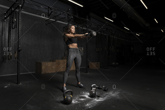 Woman lifting a kettlebell at the gym