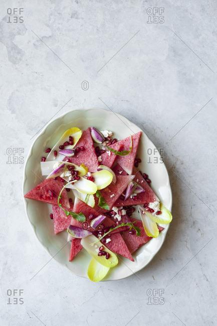 Fresh watermelon salad with pomegranates