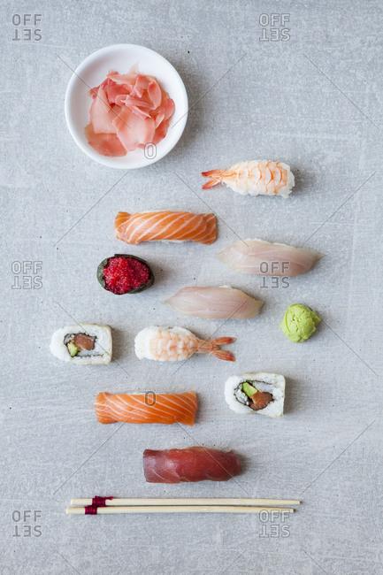 Sushi arranged on a grey background
