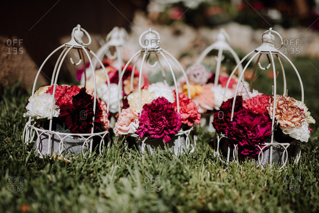 Wedding floral arrangements in wire cages