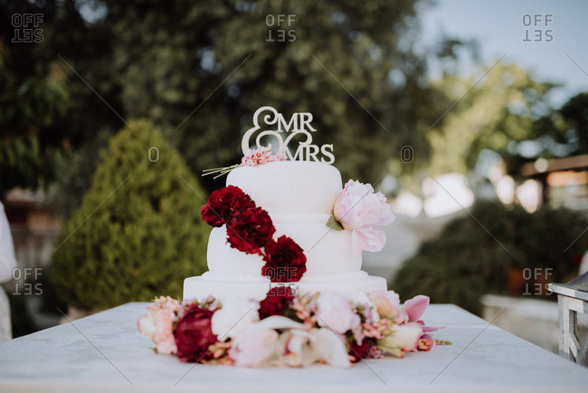 Three tiered wedding cake with peonies