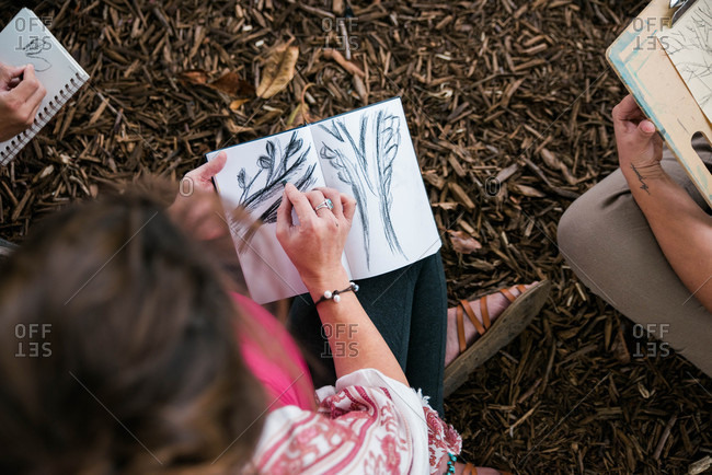 Overhead view of people sketching outdoors