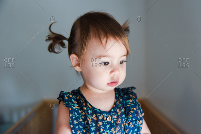 Toddler girl with hair in pigtails