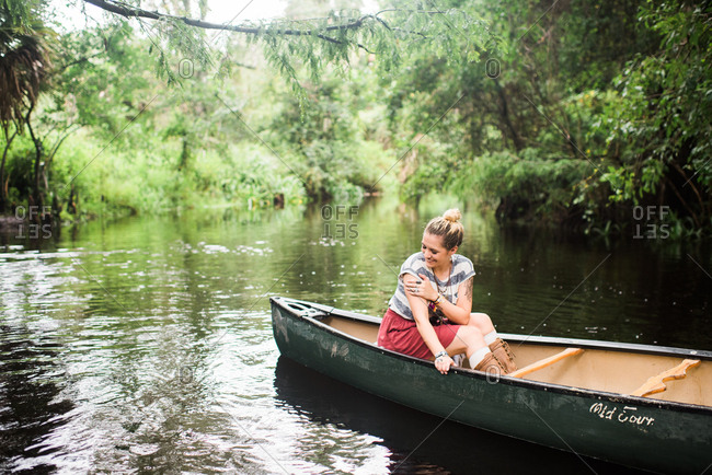 Smiling woman enjoying ride in canoe