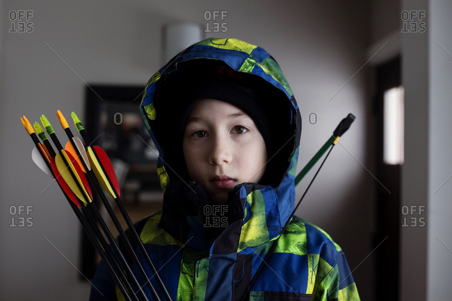 Boy holding bow and arrows