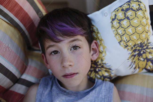 Young boy with purple streaks in his hair