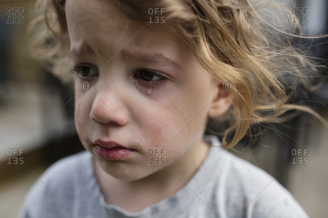 Sad little boy with tears on his face