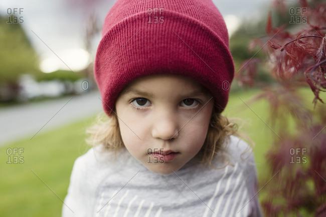 Little boy wearing red knit hat