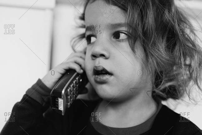 Young boy talking on cordless phone