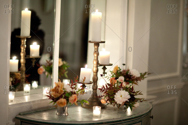 Table by window with candles and flower arrangements
