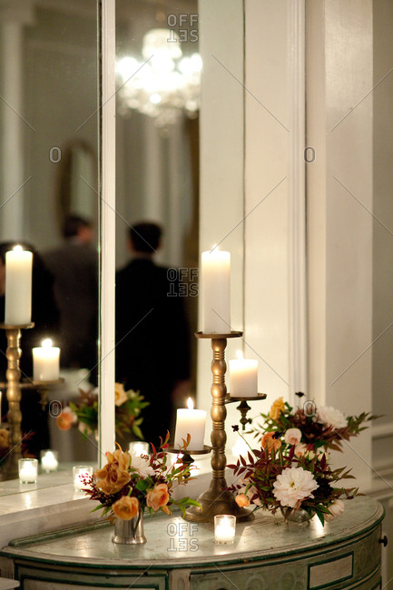 Table decorated with candles and flower arrangements