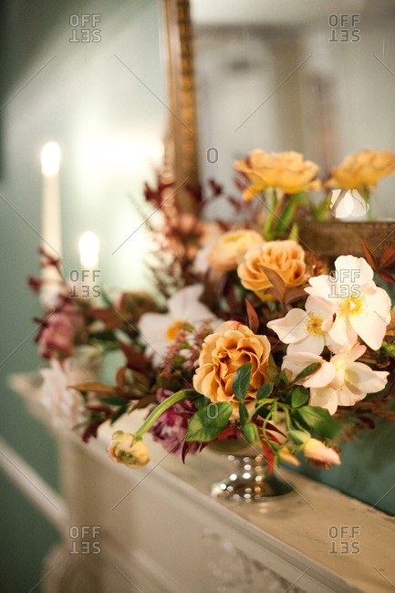 Flower arrangement on fireplace mantel