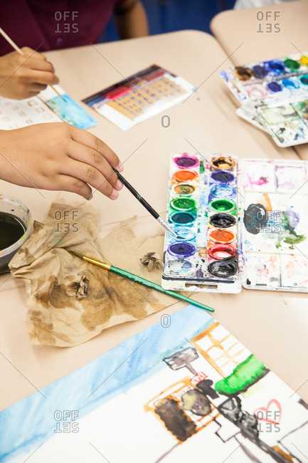 Elevated view of children painting with watercolors