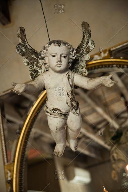 Antique cherub hanging in vintage shop